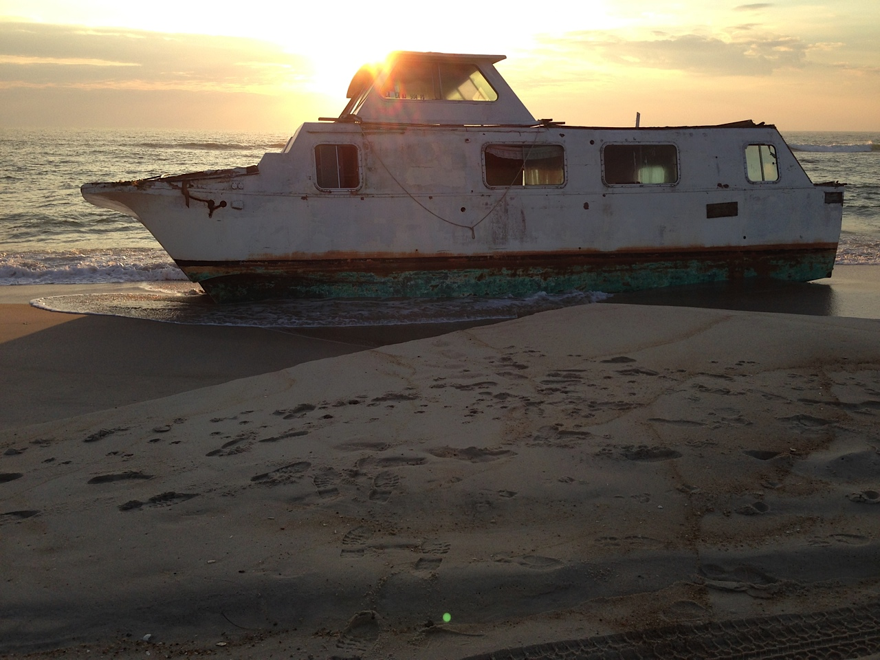 Local residents and artists Kirk McBride and Lynne Lockhart came upon this 40-foot houseboat on Thursday morning during a walk along the beach on Assateague Island's OSV area. Photo by Kirk McBride
