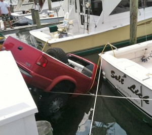 Truck Jumps Curbs, Ends Up In Marina
