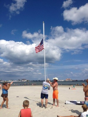 American Flag Raised On Bay Island Met With Cheers; Area Resident Joined By Others In Endeavor