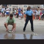 Ocean City Councilman Wayne Hartman and Animal Control Officer Barbara Wisniewski are pictured releasing two of the turtles. Photos courtesy of National Aquarium