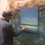 """Artist Kevin Fitzgerald is pictured putting the finishing touches on his painting, """"Morning Wave,"""" which will be auctioned at the Jan. 9 benefit. Submitted Photo"""