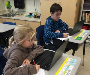 OC Elementary Fourth Graders Use Laptops To Do Research For Their Non-Experimental Science Fair Project