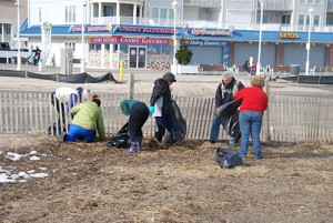 Team Of Citizen Volunteers Helping With Beach Clean-Up Effort