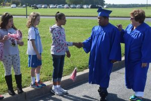 Two Cedar Chapel Students Get A Thrill Participating In Graduation Walk
