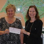 Marie Gilmore, president of the Worcester County Veterans Memorial Foundation, was presented a check by Ocean Pines Association Department of Marketing and Public Relations representative Julie Malinowski, representing the proceeds of a partnership between the OPA and BJ's Wholesale. Photo by OPA
