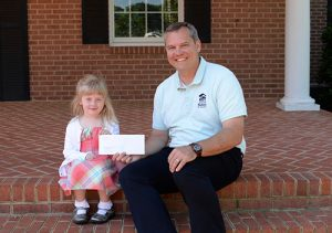 Worcester Prep Pre-Kindergartener Vivian Spraul Presents $520 Check To Habitat For Humanity