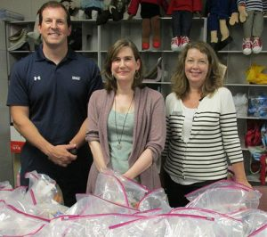 BB&T Bank Employees Purchase And Assemble Emergency Food Bags And Hygiene Kits For Worcester County GOLD