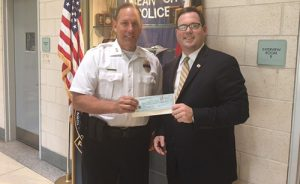 Attorney Brian H. Clark Presents $2,000 Check To OC Police