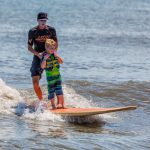Carson Green, 6, of Berlin, was one of the lucky individuals who got to go surfing this week. Photo by Chris Parypa