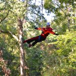 Eighth grader T.J. Bescak is pictured on a zip line course during his class field trip.