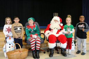 Santa And Mrs. Claus Visit OC Elementary