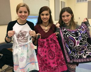 Area Seamstresses Make Dresses, Boys' Shorts, Feminine Bath Kits, Sleep Mats And Market Bags For Impoverished Children And Women In Third World Countries