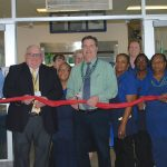 Stephen Decatur High School administrators and Board of Education officials join cafeteria staff in cutting the ribbon on the new café Tuesday.