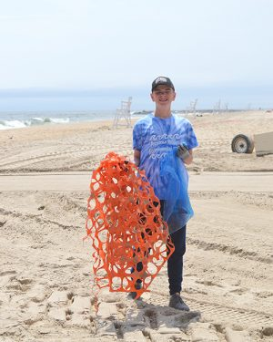 School Partners With Surfrider For OC Beach Cleanup