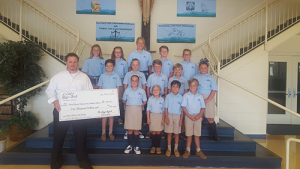 Most Blessed Sacrament Catholic School Receives Check From de Lazy Lizard