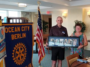 Rotary Club District Governor Elect Presents Rotary Club President With A Framed Collage