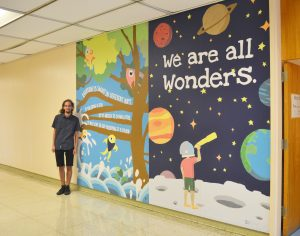 Student Paints Mural At Berlin Intermediate