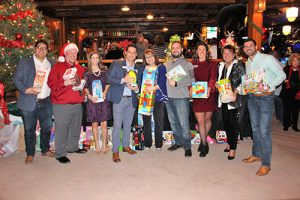 Coastal Association Of REALTORS® Members Donate To Toys For Tots