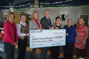 AGH Auxiliary Presents Hospital Officials With $40,000 Check