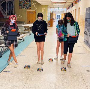BIS Sixth Graders Coding Robots