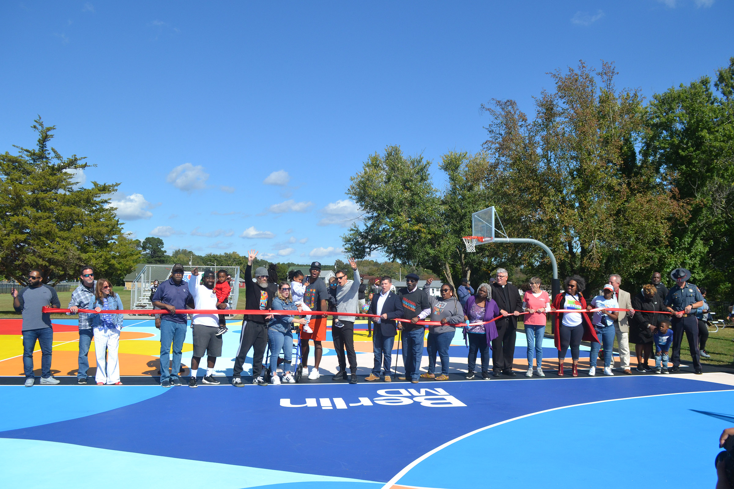 Community Celebrates Henry Park Overhaul, New Basketball Courts Mural